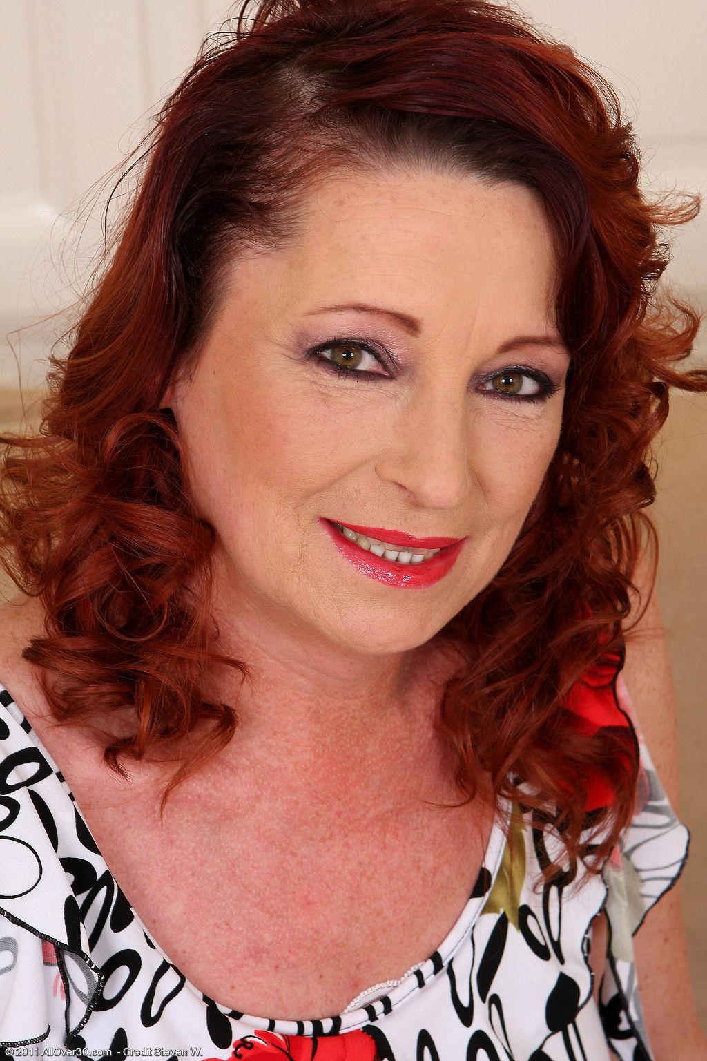 Рыжая зрелая дама 9 фотография